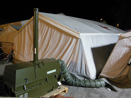 VA-M 40 heating a Red Cross tent for housing refugees & Refugees kept warm by mobile heaters in tent camps
